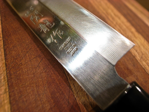 Close up of great cheap Japanese single beveled slicing knife