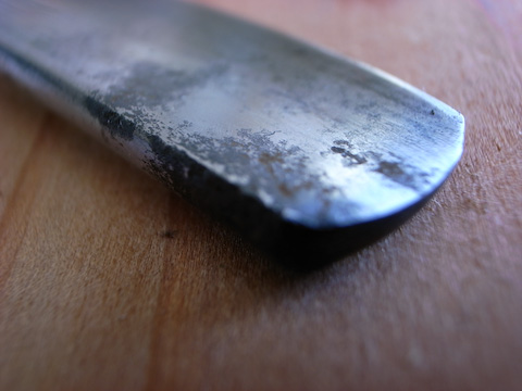 Rusty and pitted tip of a Worcester straight razor