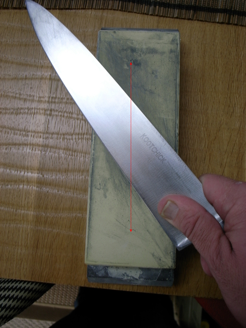 best knife sharpening in Los Angeles Hand sharpening knife diagonally to avoid wobbling