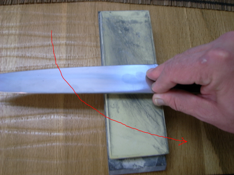 best knife sharpening in Santa Monica using edge tailing strokes on fine sharpening stone to deburr